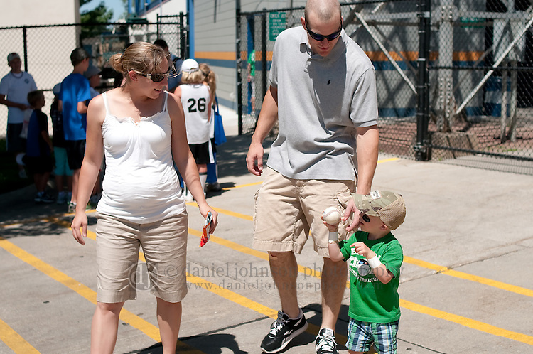 June 30, 2009 -- Omaha Royals left fielder Scott Thorman, from Cambridge, Ontario, walks with his wife, Kelly, and two-year-old son, Robbie, in the parking lot after playing against the Albuquerque Isotopes in a minor league professional baseball game on Tuesday June 30, 2009 in Omaha, Nebraska. PHOTO/Daniel Johnson