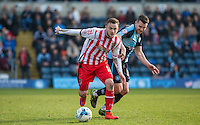 Dean Parrett of Stevenage holds off Matt Bloomfield of Wycombe Wanderers during the Sky Bet League 2 match between Wycombe Wanderers and Stevenage at Adams Park, High Wycombe, England on 12 March 2016. Photo by Andy Rowland/PRiME Media Images.