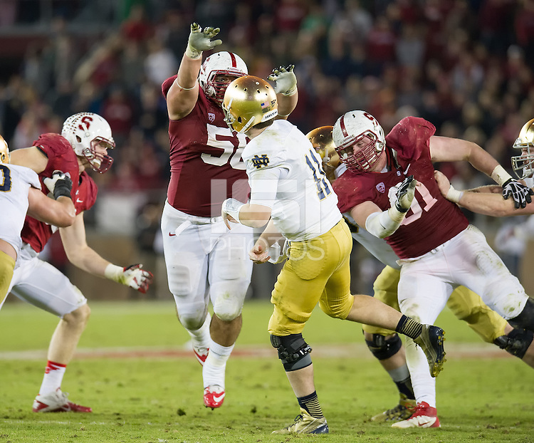 STANFORD, CA - November 30, 2013: Stanford Cardinal defensive tackles David Parry (58) and Henry Anderson (91) apply pressure to the quarterback during the Stanford Cardinal vs the Notre Dame Irish at Stanford Stadium in Stanford, CA. Final score Stanford Cardinal 27, Notre Dame Irish  20.