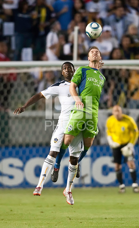 LA Galaxy forward Edson Buddle (14) goes up as Seattle Sounders defender Jeff Parke (31) heads the ball during the first half of the game between LA Galaxy and the Seattle Sounders at the Home Depot Center in Carson, CA, on July 4, 2010. LA Galaxy 3, Seattle Sounders 1.