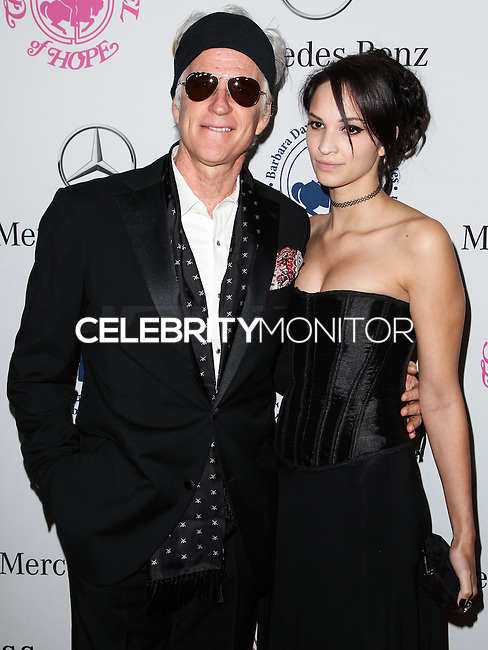 BEVERLY HILLS, CA, USA - OCTOBER 11: Matthew Modine, Ruby Wylder Modine arrive at the 2014 Carousel Of Hope Ball held at the Beverly Hilton Hotel on October 11, 2014 in Beverly Hills, California, United States. (Photo by Celebrity Monitor)