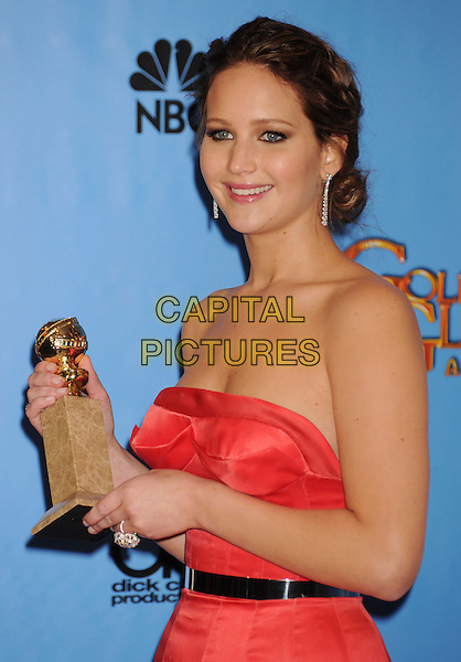 Jennifer Lawrence.Press Room at the 70th Annual Golden Globe Awards held at the Beverly Hilton Hotel, Hollywood, California, USA..January 13th, 2013.globes half length red pink strapless dress dangling diamond earrings silk satin black belt award trophy winner .CAP/GAG.©GAG/Capital Pictures