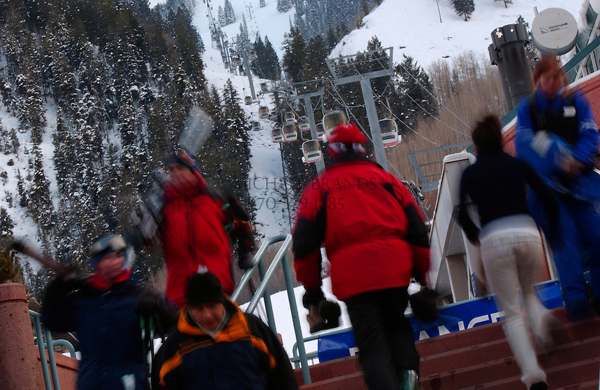 Skiers at the base of the Silver Queen Gondola in Aspen, Colorado. © Michael Brands. 970-379-1885. ski, skiing,