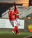 Clyde's Stefan McCluskey (10) is congratulated by Gavin Brown (2) after he scores.