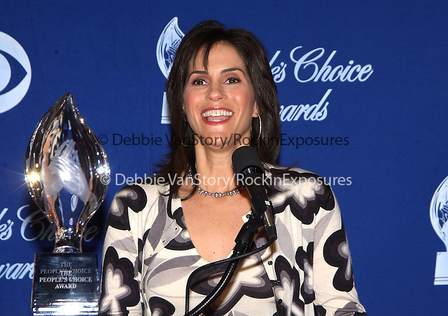 Jami Gertz announcing  The Top Vote-Getters  for The 29th Annual People's Choice Awards held at the Beverly Hilton Hotel in Beverly Hills ,California on December 4,2002.Photo by Hollywood Press Agency