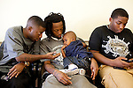 """Don Trip gets his haircut  by Master Barber Mario Jones, along with his son Jaylen, 2, at Brown's Barbershop in Memphis, Tennessee October 15, 2011. Trip's song """"A Letter to My Son"""" is about his relationship with Jaylen."""