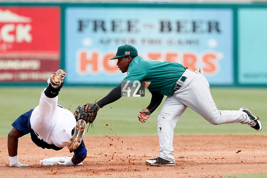 22 September 2012: Gift Ngoepe tries to tag out Rene Leveret during South Africa 5-2 win over France during the 2012 World Baseball Classic Qualifier round, in Jupiter, Florida, USA.