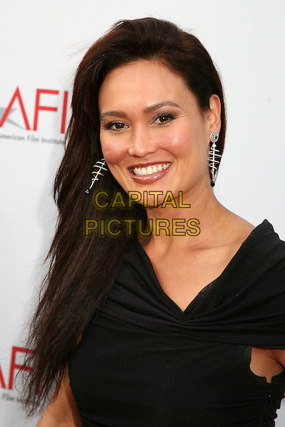 TIA CARRERE.34th AFI Life Achievement Award honoring Sir Sean Connery - Arrivals held at the Kodak Theatre, Hollywood, California, USA, 08 June 2006..portrait headshot.Ref: ADM/BP.www.capitalpictures.com.sales@capitalpictures.com.©Byron Purvis/AdMedia/Capital Pictures.