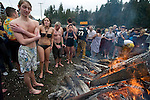 First time jumpers Brad Lewis, ( L to R),  Elizabeth Levenstiler, Micheal Parish,  and Patty Anderson warm up after jumping in the 24th annual Polar Bear Jump into the Burley Lagoon in Olalla, Washington on January 1, 2008. Jim Bryant Photo. ©2010. ALL RIGHTS RESERVED.