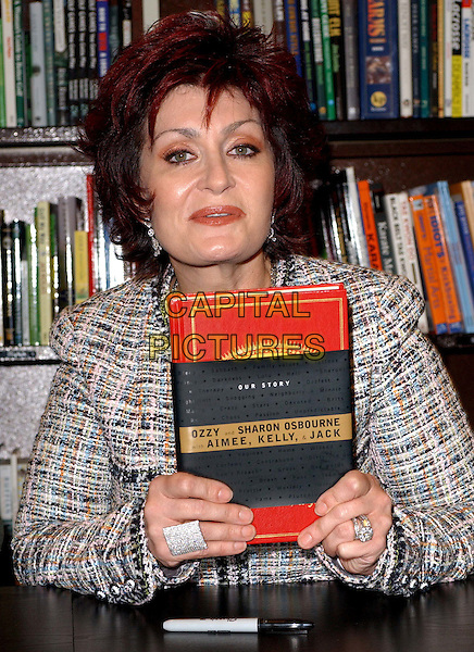 """SHARON OSBOURNE.signs the Osbourne family's new book """"Ordinary People: Our Story"""" at the Barnes & Noble at The Grove at .Farmers Market in Los Angeles, California.19 February 2004                                                                                                                              *UK Sales Only*.www.capitalpictures.com.sales@capitalpictures.com.©Capital Pictures."""