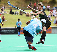 NZ's Simon Child tries to block Sandeep Singh's pass during the international hockey match between the New Zealand Black Sticks and India at National Hockey Stadium, Wellington, New Zealand on Saturday, 20 February 2009. Photo: Dave Lintott / lintottphoto.co.nz