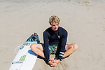 Surfer John John Florence stretches on the beach in Santa Monica, California September 30, 2015. <br /> CREDIT: Kendrick Brinson for The Wall Street Journal<br /> WORKOUT_florence