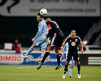 Robbie Russell (3) of D.C. United goes up for a header with Bobby Convey (11) of Sporting KC brings the ball up the field during the game at RFK Stadium in Washington, DC.  Sporting KC defeated D.C. United, 1-0.