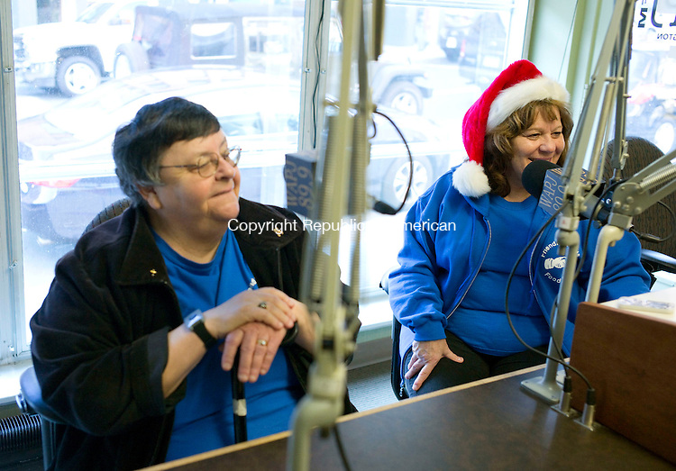 Torrington, CT- 05 December 2015-120515CM02-  Mo Hubert executive director, left, and Tina Hasapis, assistant director at the Friendly Hands Food Drive, talk about a toy and food drive put on by WAPJ, Torrington's community radio station and the Drakeville Volunteer Fire Department inside the radio station in Torrington on Saturday.   Proceeds from the event will go towards the Friendly Hands Food Bank.      Christopher Massa Republican-American