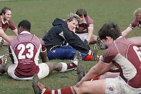 01 MAR 2008 - SCUNTHORPE, UK - Loughborough Students physiotherapist Paula Wild guides players through their post match stretches - Scunthorpe RUFC  v Loughborough Students RUFC. (PHOTO (C) NIGEL FARROW)