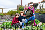 Daniele Giovannelli with his children picking fresh produce.