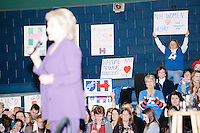 People watch as former Secretary of State and Democratic presidential candidate Hillary Rodham Clinton speaks at a rally at Nashua Community College in Nashua, New Hampshire, on Tues. Feb. 2, 2016. Former president Bill Clinton also spoke at the event. The day before, Hillary Clinton won the Iowa caucus by a small margin over Bernie Sanders.