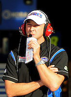 Oct. 9, 2009; Fontana, CA, USA; NASCAR Sprint Cup Series crew chief Chad Knaus during qualifying for the Pepsi 500 at Auto Club Speedway. Mandatory Credit: Mark J. Rebilas-