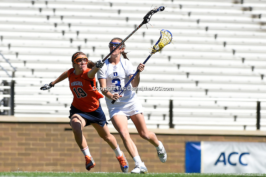 Virginia's Maddy Keeshan (19) blocks the stick of Duke's Maddy Morrissey (3)  during the 2014 ACC Women's Lacrosse Quarterfinals in Boston, MA, Thursday, April 24, 2014. (Photo by Eric Canha,<br /> theACC.com)