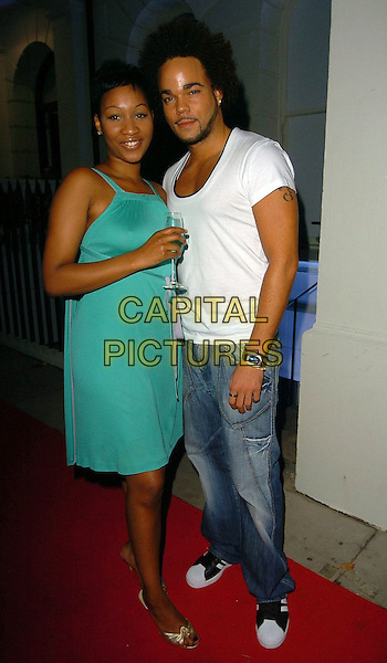 TERRI WALKER & NATE JAMES.Hempel Hotel relaunch party.London 13th October 2005.Ref: AH.full length glass of champagne blue denim jeans white t-shirt.www.capitalpictures.com.sales@capitalpictures.com.©Capital Pictures