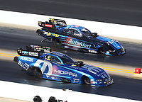 Oct 14, 2019; Concord, NC, USA; NHRA funny car driver Matt Hagan (near) alongside Bob Tasca III during the Carolina Nationals at zMax Dragway. Mandatory Credit: Mark J. Rebilas-USA TODAY Sports