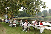 People enjoy wine along the lake at the Boar's Head Inn during the Monticello Wine Festival
