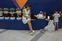 A Chinese family enjoy a quiet time at the Dongguan Science and Technology Museum Dongguan, Guangdong province, China, August 2016.
