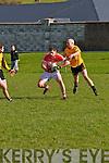 Daingean Úi Chúis Pól Ó Géibheannaigh tackled by Listowel Emmets Jake Moriarty during the CFL Div. 1 match at Pairc an Aghasaigh, Dingle, on Sunday afternoon.
