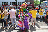 New York, NY Saturday, June 14, 2014: Colombia fans hang out on the street during halftime of the Colombia vs. Greece first round World Cup match in the Jackson Heights neighborhood of Queens, New York.