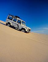 Tunisia, Nefta: Jeep descending a sand dune