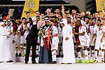 FIFA president Gianni Infantino (L) gives the Asian Cup trophy for Hasan Al Haydos of Qatar (R) during the AFC Asian Cup UAE 2019 Final match between Japan (JPN) and Qatar (QAT) at Zayed Sports City Stadium  on 01 February 2019 in Abu Dhabi, United Arab Emirates. Photo by Marcio Rodrigo Machado / Power Sport Images