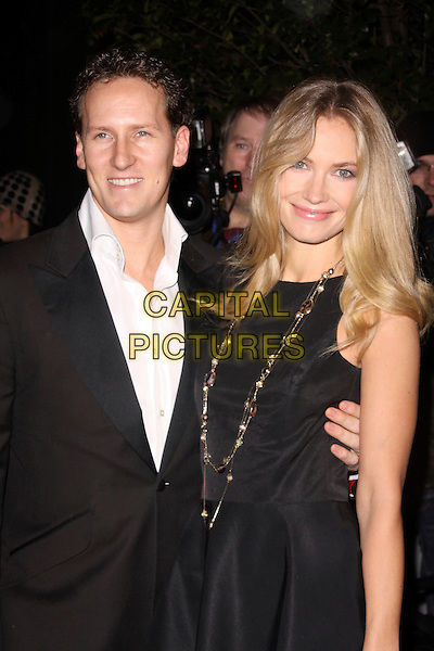 BRENDAN COLE & ZOE HOBBS.Attending the Gala Performance of the English National Ballet's 'The Nutcracker' at the Coliseum, London, England, UK..December 15th 2010.half length black suit jacket dress gold necklace sleeveless couple .CAP/AH.©Adam Houghton/Capital Pictures.