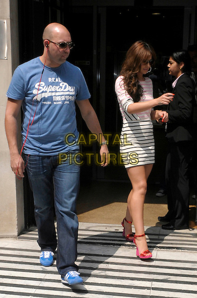 Cheryl Cole leaving BBC Radio 2, London, England..29th May 2012.full length white black pink striped stripes dress sunglasses shades minder bodyguard security blue t-shirt jeans denim red sandals ankle strap shoes.CAP/IA.©Ian Allis/Capital Pictures.