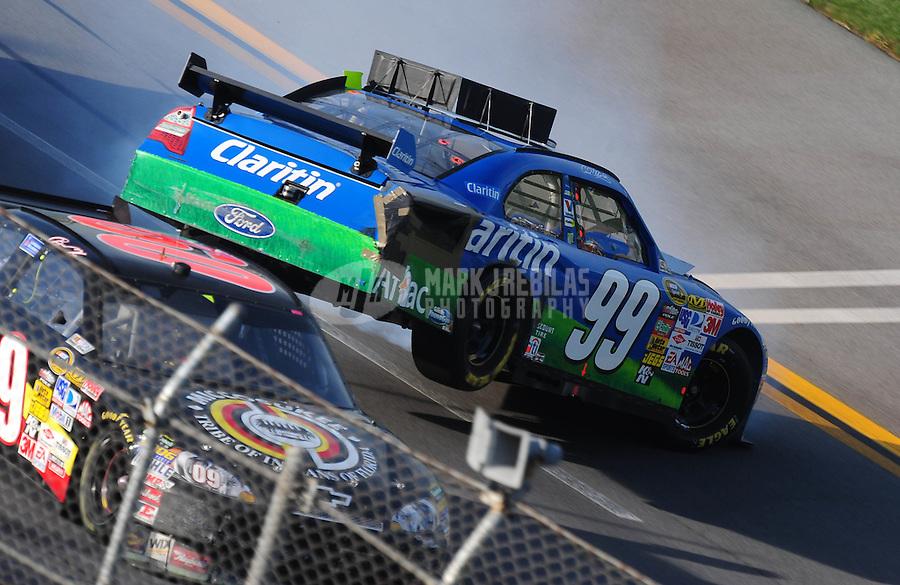 Apr 26, 2009; Talladega, AL, USA; NASCAR Sprint Cup Series driver Brad Keselowski goes high to avoid Carl Edwards (99) as he goes airborne on the last lap during the Aarons 499 at Talladega Superspeedway. Mandatory Credit: Mark J. Rebilas-