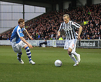 Gary Teale takes on Liam Craig in the St Mirren v St Johnstone Clydesdale Bank Scottish Premier League match played at St Mirren Park, Paisley on 8.12.12.