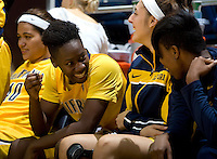 Afure Jemerigbe of California shares some laughs with Tierra Rogers of California during the game against St. Mary's at Haas Pavilion in Berkeley, California on November 15th, 2012.  California defeated St. Mary's, 89-41.