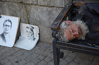 Romania. Iași County. Iasi. A homeless man sleeps on a bench. On the ground, two drawings by a street artist, one of a man's portrait and the other of a woman's portrayal. Iași (also referred to as Iasi, Jassy or Iassy) is the largest city in eastern Romania and the seat of Iași County. Located in the Moldavia region, Iași has traditionally been one of the leading centres of Romanian social life. The city was the capital of the Principality of Moldavia from 1564 to 1859, then of the United Principalities from 1859 to 1862, and the capital of Romania from 1916 to 1918. 8.06.15 © 2015 Didier Ruef