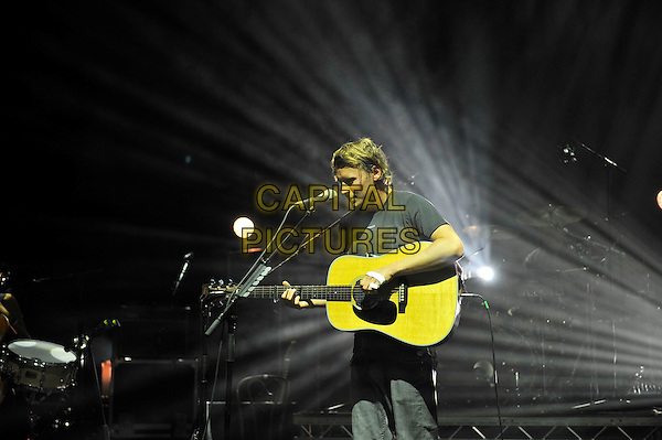 Ben Howard <br /> performing in concert, Hammersmith Apollo, London, England. <br /> 12th June 2013<br /> on stage live gig performance music half length black t-shirt guitar singing <br /> CAP/MAR<br /> &copy; Martin Harris/Capital Pictures