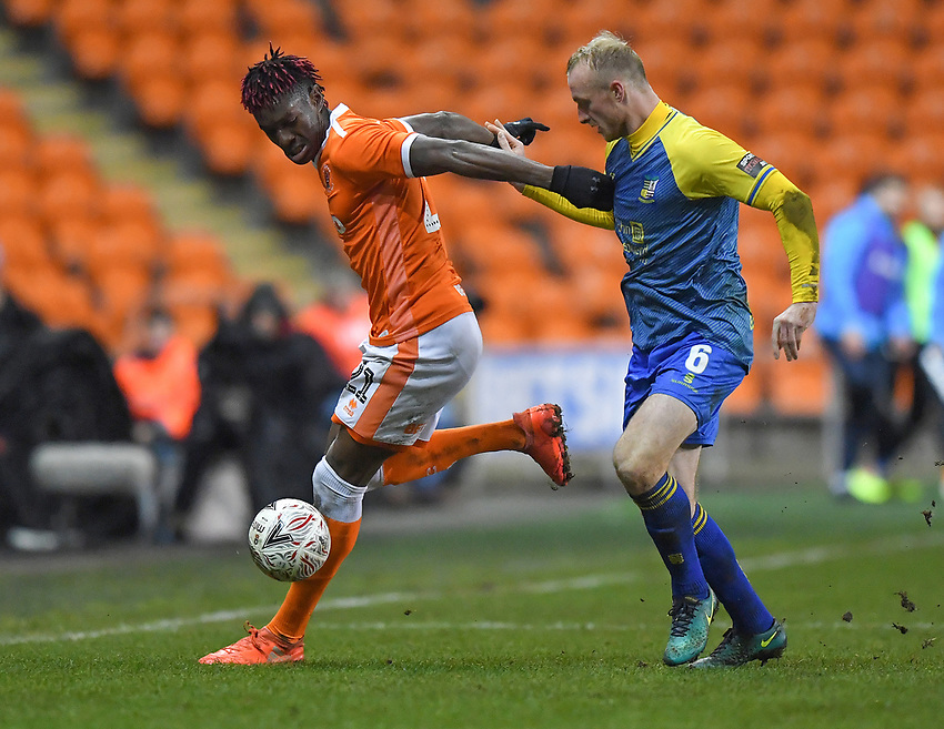 Blackpool's Armand Gnanduillet holds off Solihull Moors' Alex Gudger<br /> <br /> Photographer Dave Howarth/CameraSport<br /> <br /> The Emirates FA Cup Second Round Replay - Blackpool v Solihull Moors - Tuesday 18th December 2018 - Bloomfield Road - Blackpool<br />  <br /> World Copyright © 2018 CameraSport. All rights reserved. 43 Linden Ave. Countesthorpe. Leicester. England. LE8 5PG - Tel: +44 (0) 116 277 4147 - admin@camerasport.com - www.camerasport.com