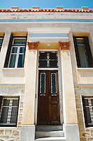 neoclassical building...After returning to Greece, architect, George Evripiotis,  chose to live with his wife, Aline, in this neoclassical house on the island of Syros,