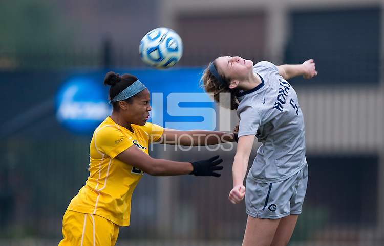 Marina Paul (5) of Georgetown goes up for a header with Deja Davis (29) of La Salle during the first round of the NCAA tournament at Shaw Field in Washington, DC.  Georgetown defeated La Salle, 2-0.