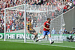 LONDON, ENGLAND - MAY 12: York City's Matty Blair celebrates his opening goal as the ball hits the back of the net for York City in the FA Carlsberg Trophy Final between York City and Newport County at Wembley Stadium on May 12, 2012 in London, England. (Photo by Dave Horn - Extreme Aperture Photography)