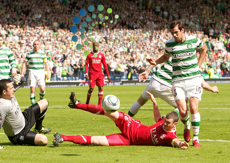 The  Scottish FA Cup, Semi Final. Season 2010/11.Aberdeen Football Club  V Celtic Football Club...17-04-11...  Aberdeen's Zander Diamond clears after Stokes missed penalty  , in this afternoon's Scottish FA Cup, Semi Final tie between, Scottish Premier League sides Aberdeen and Celtic. With the winner meeting Motherwell in this year's Final...At Hampden Park Stadium, Glasgow...Picture, Mark Davison/Universal News and Sport (Scotland) .Sunday 17th April  2011.