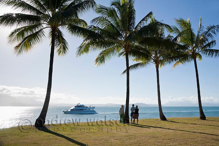 Tourist boat heading back to port viewed from Rex Smeal Park.  Port Douglas, Queensland, Australia