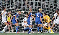 Allston, Massachusetts - July 9, 2015:   In a National Women's Soccer League (NWSL) match, FC Kansas City (white) defeated Boston Breakers (blue), 3-2, at Soldiers Field Soccer Stadium. Morgan Marlborough scores with a header.