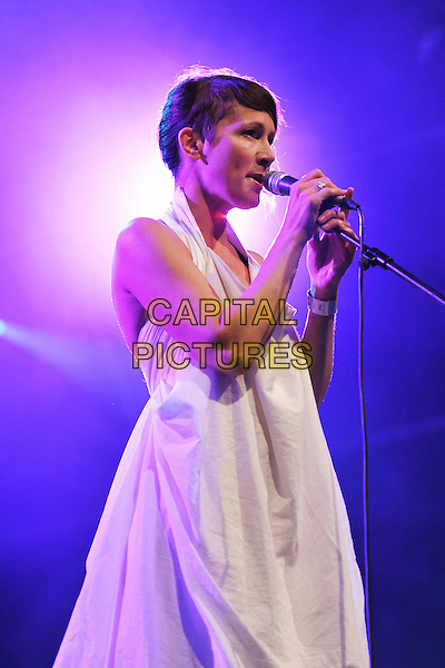 Lou Rhodes of Lamb .Lamb performing live in concert at Somerset House, London, England, UK, 16th July 2011..music half length gig on stage singing microphone white dress side profile .CAP/MAR.© Martin Harris/Capital Pictures.