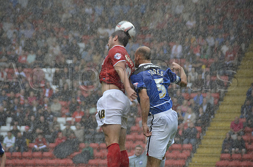 24.08.2013. The Valley, Charlton, London, England. FA Championship football. Charlton FC versus Doncaster Rovers.  Kermognant and Rob Jones challenge for the ball