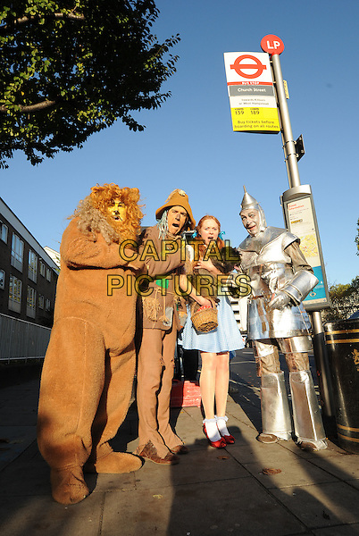 WIZARD OF OZ - Dorothy Gale, her faithful dog, Toto, the Cowardly Lion, the Tin Man and the Scarecrow .Wizard of Oz characters hit London streets to celebrate the 70th Anniversary release of the ultimate Sing-Along edition DVD & Blu-Ray..November 2nd, 2009.full length church street bus station stop mouth open street costume silver fur blue dress.CAP/PLF.Supplied by Capital Pictures.