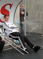 Pictured: Alan Tate of Swansea with his injured leg after a golf buggy accident. Saturday 17 September 2011<br /> Re: Premiership football Swansea City FC v West Bromwich Albion at the Liberty Stadium, south Wales.