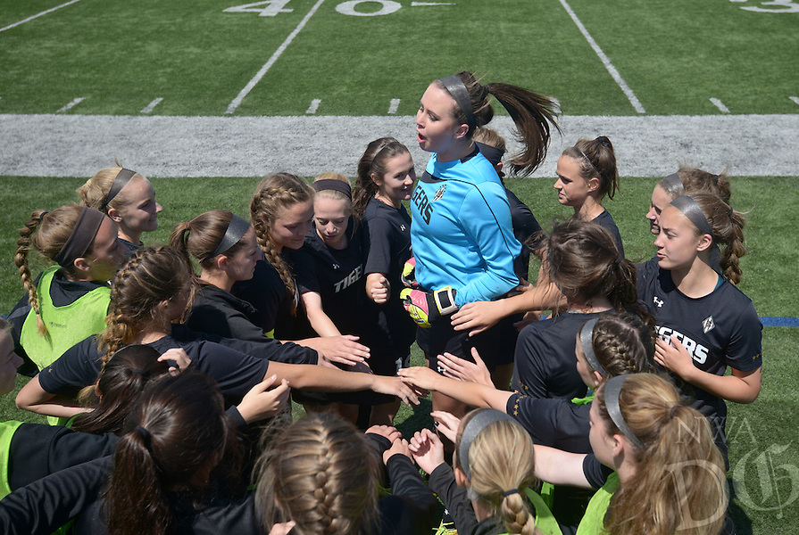NWA Democrat-Gazette/BEN GOFF @NWABENGOFF<br /> Bentonville players huddle at halftime on Saturday May 14, 2016 during the girls soccer class 7A state semifinal game against Bryant at Springdale Har-Ber's Wildcat Stadium.